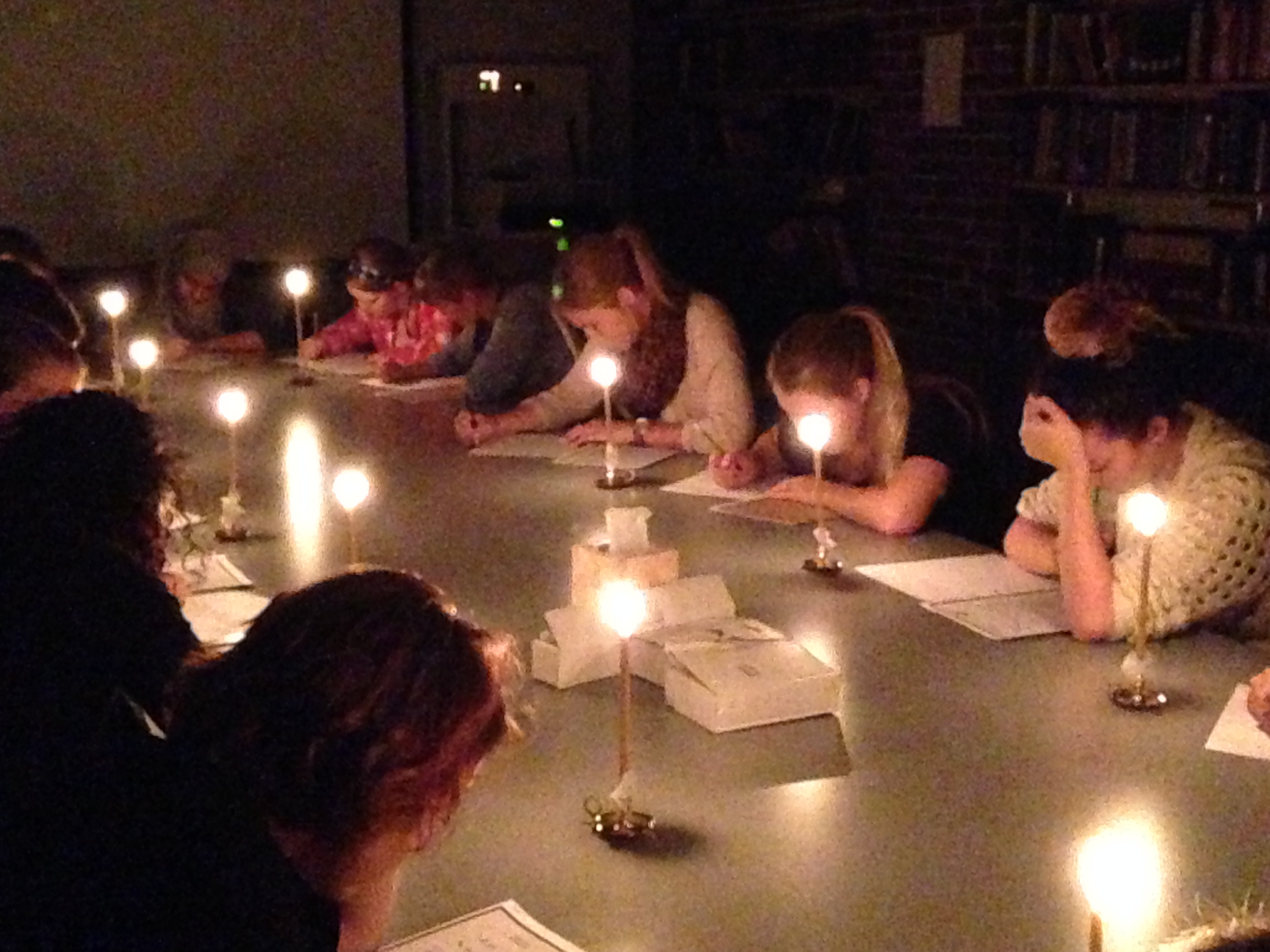 Students in my Technologies of Text class transcribe by candlelight.